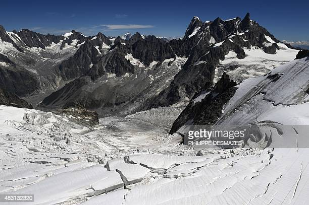 This picture taken on August 5 2015 in Chamonix shows the seracs and crevasses of the Glacier des Géants with the MontBlanc mountain behind taken...