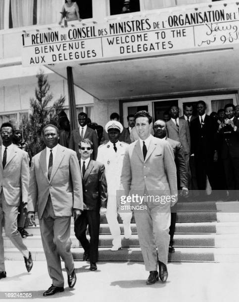 This picture taken on August 6 1963 shows Algerian President Ahmed Ben Bella flanked by Senegalese Foreign minister Doudou Thiam and Algerian...
