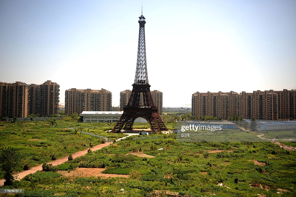 This picture taken on August 7, 2013 shows a replica of the Effel Tower in Tianducheng, a luxury real estate development located in Hangzhou, east China's Zhejiang province. China's ability to reproduce foreign products is best known for imitation luxury purses and copies of Hollywood films. But knockoffs have ranged from a three-dollar version of Kate Middleton's engagement ring to fake Apple stores and an entire Austrian village. CHINA