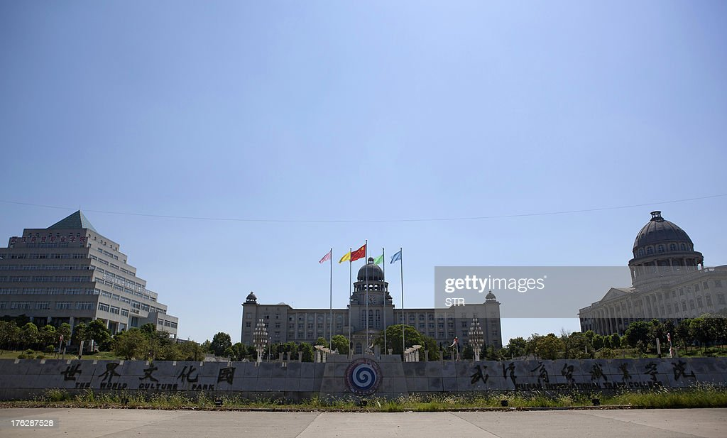 This picture taken on August 9, 2013 shows a general view of the campus with replicas of world famous architecture at a college in Wuhan, in central China's Hubei province. China's ability to reproduce foreign products is best known for imitation luxury purses and copies of Hollywood films. But knockoffs have ranged from a three-dollar version of Kate Middleton's engagement ring to fake Apple stores and an entire Austrian village. CHINA