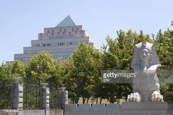 This picture taken on August 9 2013 shows a replica of the Sphinx and a pyramidshaped building which is actually a library at a college in Wuhan...