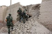 This picture taken on August 9 2014 shows police looking for fugitive 'terrorists' in Aksu in northeast China's Xinjiang region Beijing has blamed a...