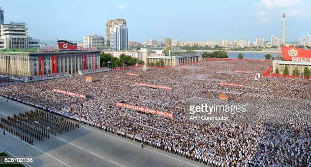 This picture taken on August 9 2017 and released by North Korea's official Korean Central News Agency on August 10 2017 shows a rally in support of...