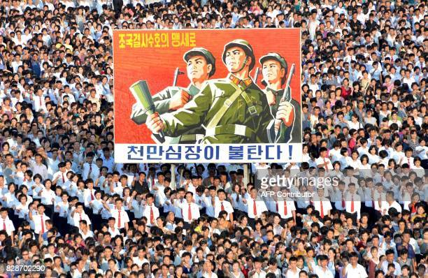 TOPSHOT This picture taken on August 9 2017 and released by North Korea's official Korean Central News Agency on August 10 2017 shows a rally in...