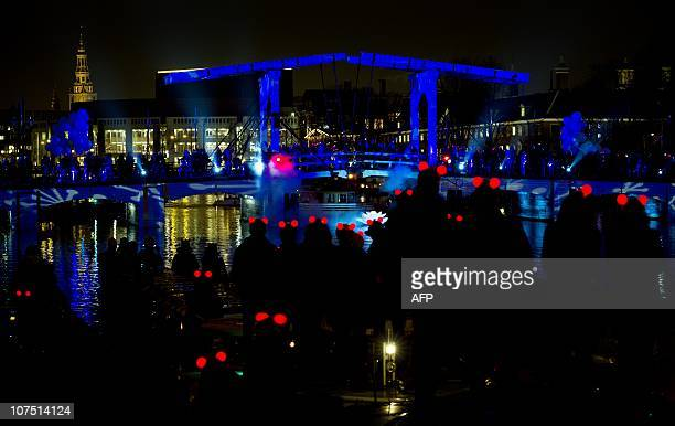 This picture taken on December 10 2010 shows the Christmas event 'Winter Magic' in Amsterdam The so called 'Magere Brug' and some thirty boats have...