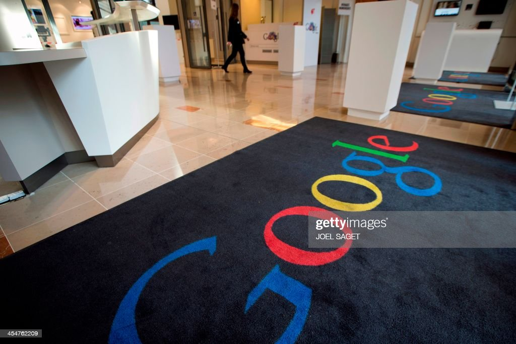 This picture taken on December 10, 2013 shows a rug with Google's logo at the Google cultural hub in Paris. The Lab is a place in the French capital designed to enable artists, museums, foundations and other cultural players to meet the US giant's engineers and gain access to its technology. France's culture minister on December 10 cancelled her attendance at the Paris launch of the Google cultural hub at the last minute, in a snub to the US giant over data protection and other issues.