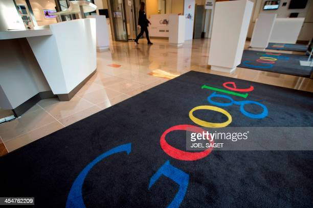 This picture taken on December 10 2013 shows a rug with Google's logo at the Google cultural hub in Paris The Lab is a place in the French capital...