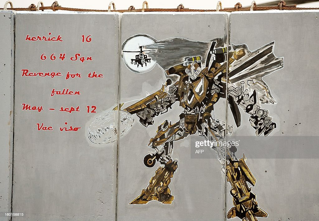This picture taken on December 12, 2012 shows a mural from 664 Squadron painted on a blast wall at Camp Bastion in Afghanistan's Helmand province. AFP PHOTO/POOL/ John Stillwell