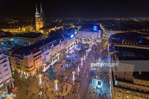 BRIEN This picture taken on December 13 2015 shows a general view of Ban Jelacic Square in central Zagreb on December 13 2015 With an ice sculpture...