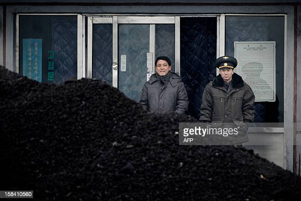 This picture taken on December 14 2012 from China's northeastern city of Dandong looking across the border shows a North Korean military officer and...