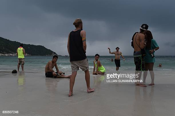 This picture taken on December 15 2016 shows partygoers on Haad Rin beach the morning after a Full Moon Party on the southern island of Ko Phangan...