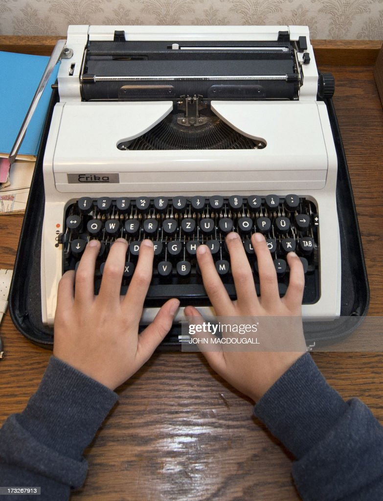 This picture taken on December 16, 2012 shows a man trying a typewriter in a Berlin Museum. A Russian state service in charge of safeguarding Kremlin communications is looking to purchase an array of old-fashioned typewriters to prevent leaks from computer hardware, sources said on July 11, 2013. The throwback to the paper-strewn days of Soviet bureaucracy has reportedly been prompted by the publication of secret documents by anti-secrecy website WikiLeaks and the revelations leaked by former US intelligence employee Edward Snowden.