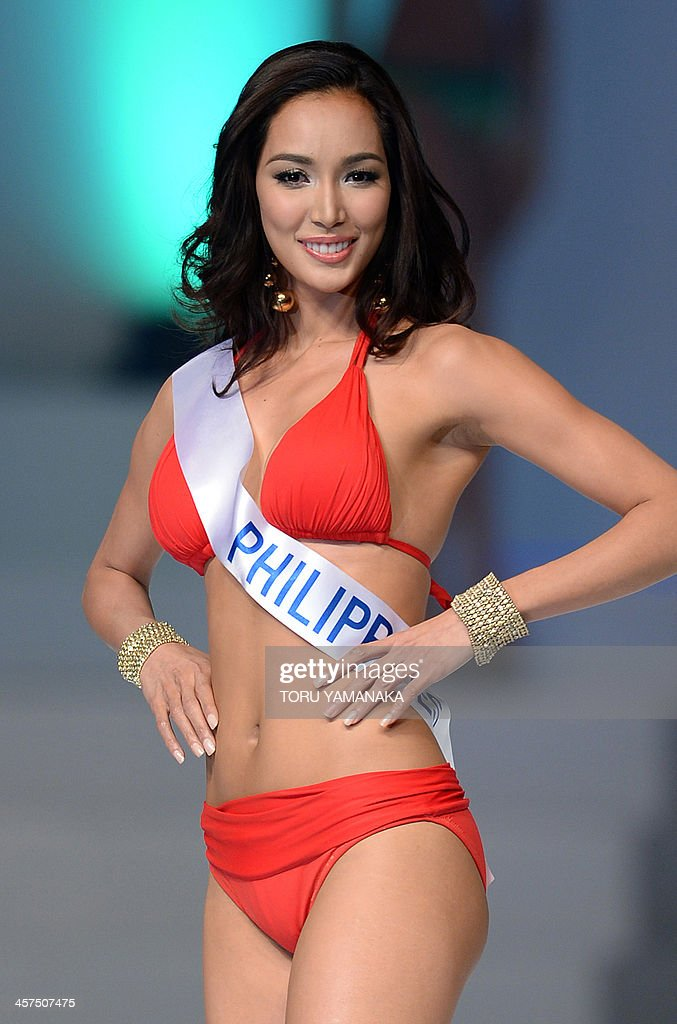 This picture taken on December 17, 2013 shows Bea Rose Santiago of the Philippines in a swim suit posing on the stage during the Miss International Beauty Pageant in Tokyo. The 23-year-old Philippine beauty queen was crowned Miss International in a pageant marred by allegations of intimidation that kept her predecessor away -- pledging to use her title to help victims of the country's devastating typhoon. AFP PHOTO / Toru YAMANAKA