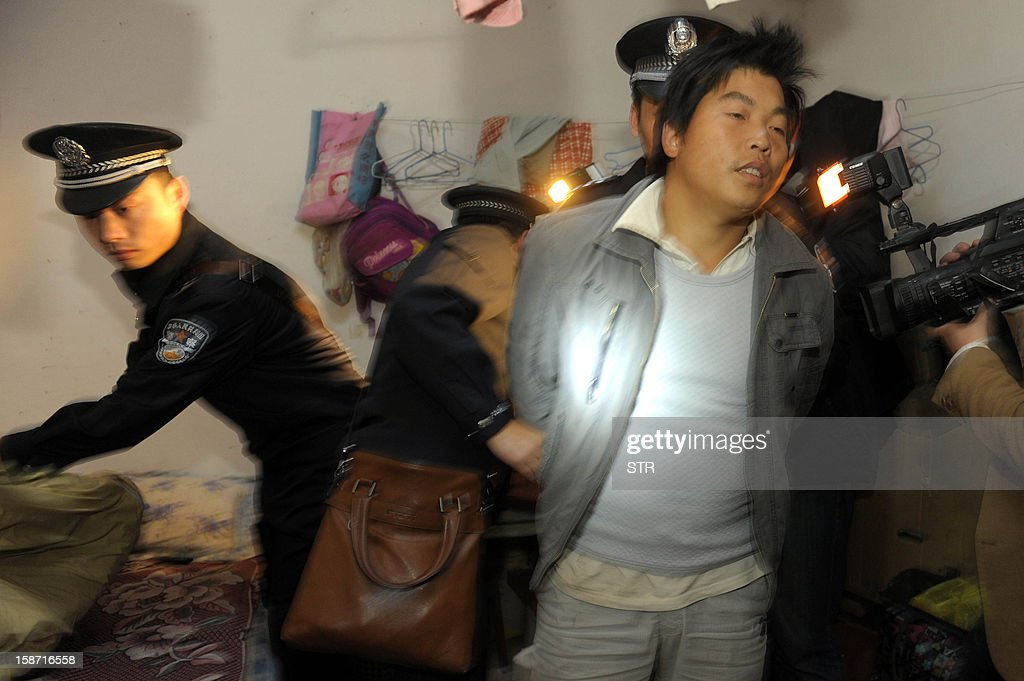 This picture taken on December 18, 2012 shows policemen arresting a child trafficking suspect (C) in Xichang, southwest China's Sichuan province. Police have detained two officials, including a family planning functionary, in China's latest crackdown on child-trafficking that has ensnared 355 suspects, state media said December 26. CHINA OUT AFP PHOTO