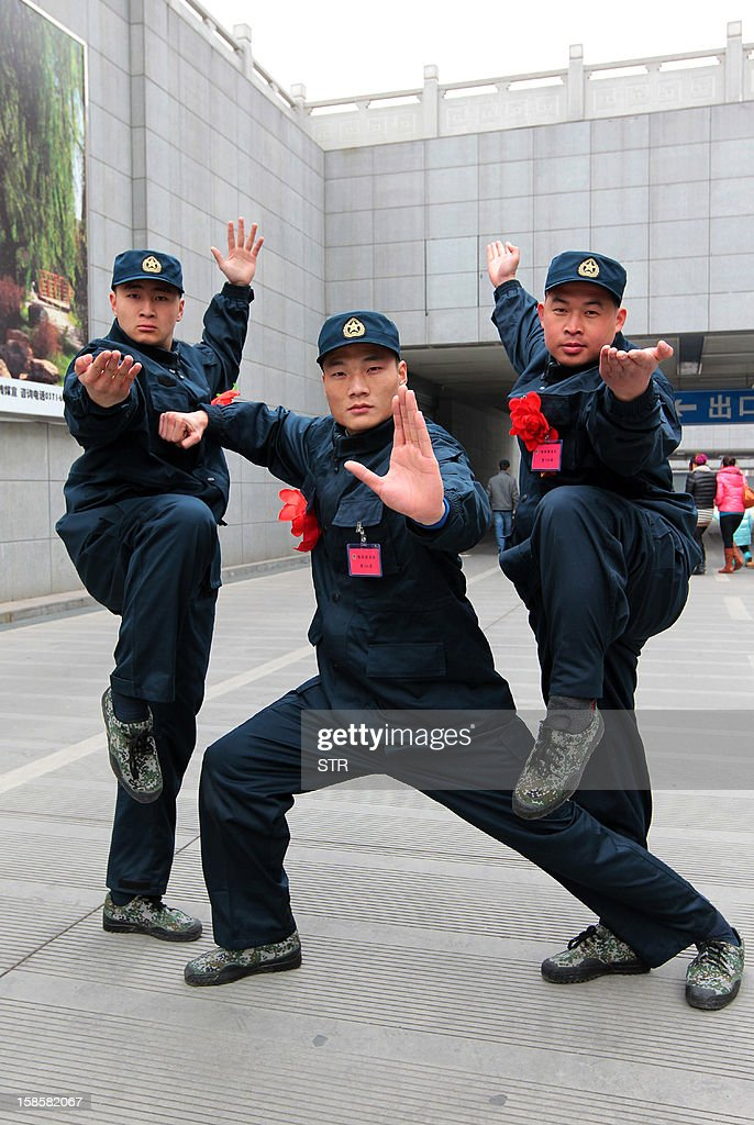 This picture taken on December 19, 2012 shows three kung fu masters from the Songshan Shaolin Kung Fu College posing for a photo before they join the PLA Navy Marine Corps in Zhengzhou, central China's Henan province. More than 30 kung fu masters were expected to join the South China Sea Fleet in Zhanjiang from Henan. CHINA