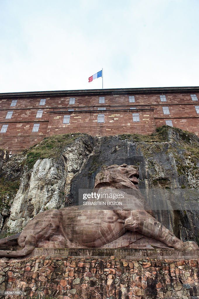 This picture taken on December 19, 2013 in Belfort, eastern France, shows Belfort's famous lion sculpture, in front of the fortress designed by Vauban.