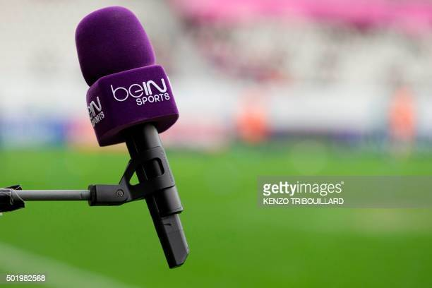 This picture taken on December 19 2015 shows a microphone labelled with bein sports TV logo prior to the European Rugby Champions Cup match beetween...