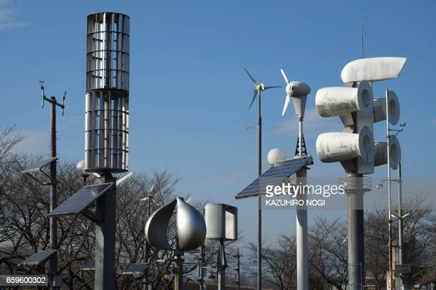 This picture taken on December 20 2016 shows windmills for wind power generation from the world displayed at the natural energy square in Ashikaga...