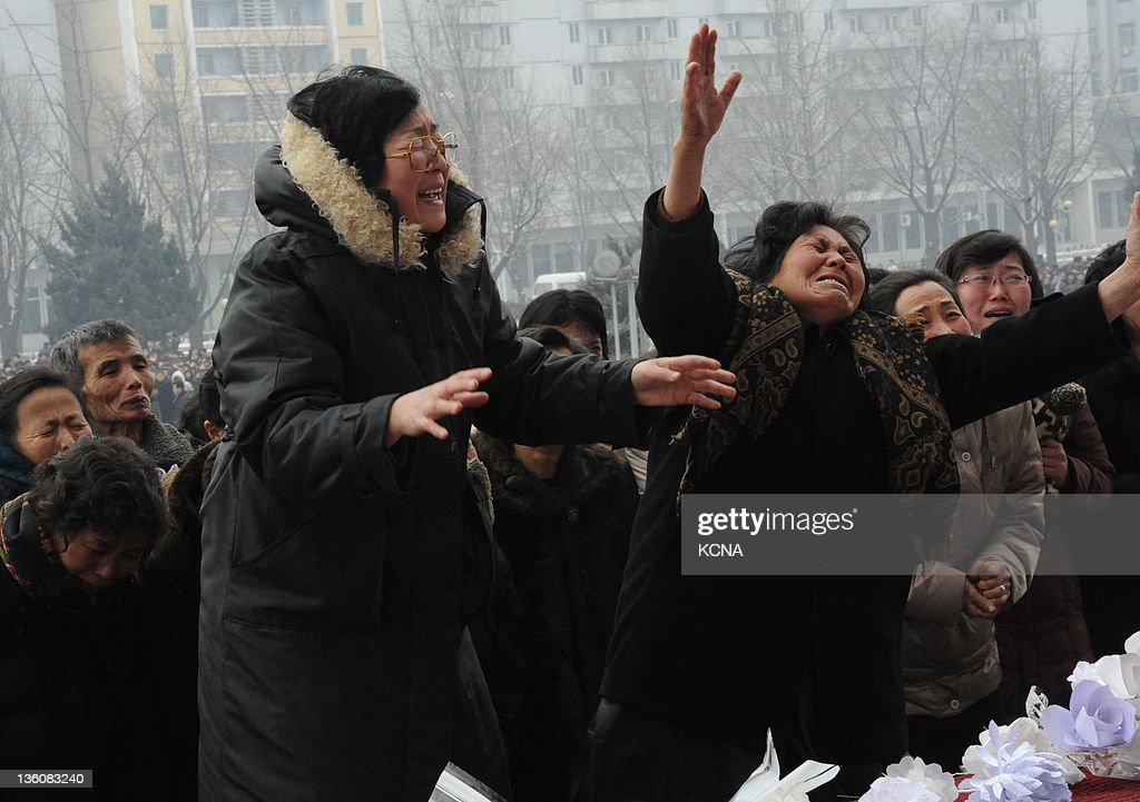 This picture taken on December 21 2011 shows Pyongyang citizens gathering to mourn the late North Korean leader Kim Jongil at the Pyongyang Gymnasium...