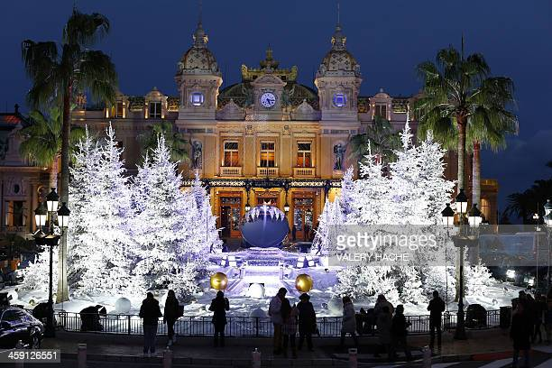 This picture taken on December 23 2013 shows the Christmas lights and Christmas trees in front of the MonteCarlo Casino in Monaco AFP PHOTO / VALERY...