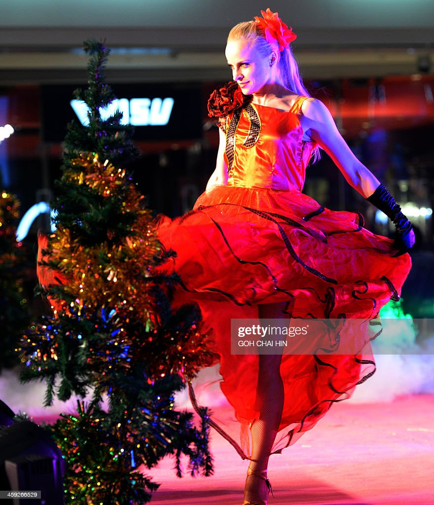 This picture taken on December 24, 2013 shows a dancer performing at a Christmas gala at a shopping mall in Beijing, as Chinese businesses cash in on the commercial value of the Christian festival. Annual growth rates above 10 percent were once common during China's metamorphosis from a classic communist-style command economy to the state-private hybrid unleashed by reforms introduced by Deng Xiaoping in the late 1970s, and in the process, hundreds of millions of Chinese were lifted out of poverty as the economy enjoyed a decades-long boom.