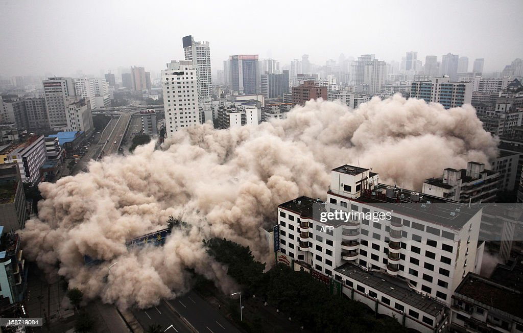 This picture taken on December 25, 2012 shows a building being demolished in Haikou, south China's Hainan province. For the past two years, China has sought to control residential property prices with measures including restrictions on second and third home purchases, higher minimum downpayments, and annual taxes in some cities on multiple and non-locally-owned homes. CHINA OUT AFP PHOTO
