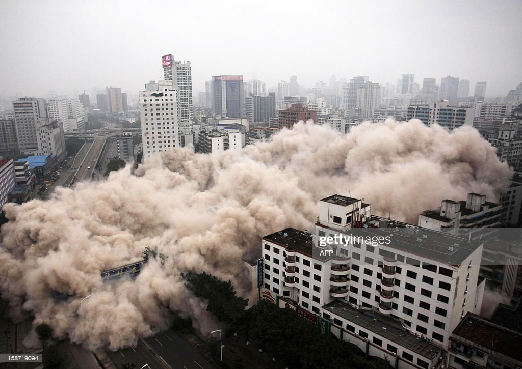 This picture taken on December 25, 2012 shows a building being demolished in Haikou, south China's Hainan province. For the past two years, China has sought to control residential property prices with measures including restrictions on second and third home purchases, higher minimum downpayments, and annual taxes in some cities on multiple and non-locally-owned homes. CHINA