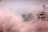 This picture taken on December 25 2012 shows a plume of dust after a building was demolished in Haikou south China's Hainan province For the past two...