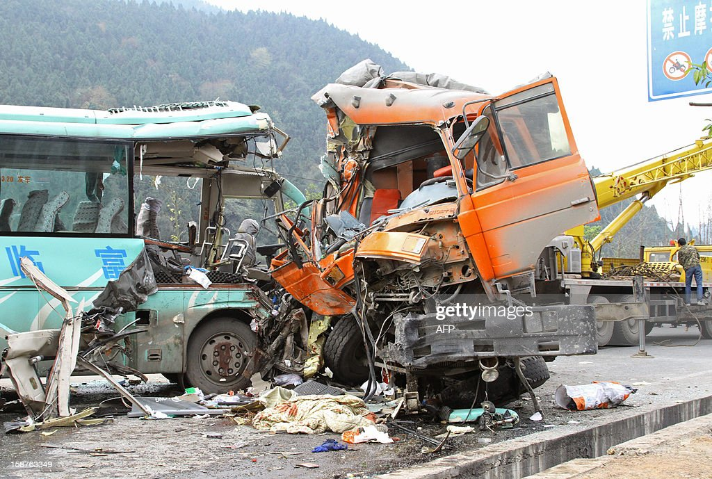 This picture taken on December 27, 2012 shows the aftermath following an accident between vehicles in Renshou, southwest China's Sichuan province. The accident resulted in seven dead and 19 injured. CHINA OUT AFP PHOTO