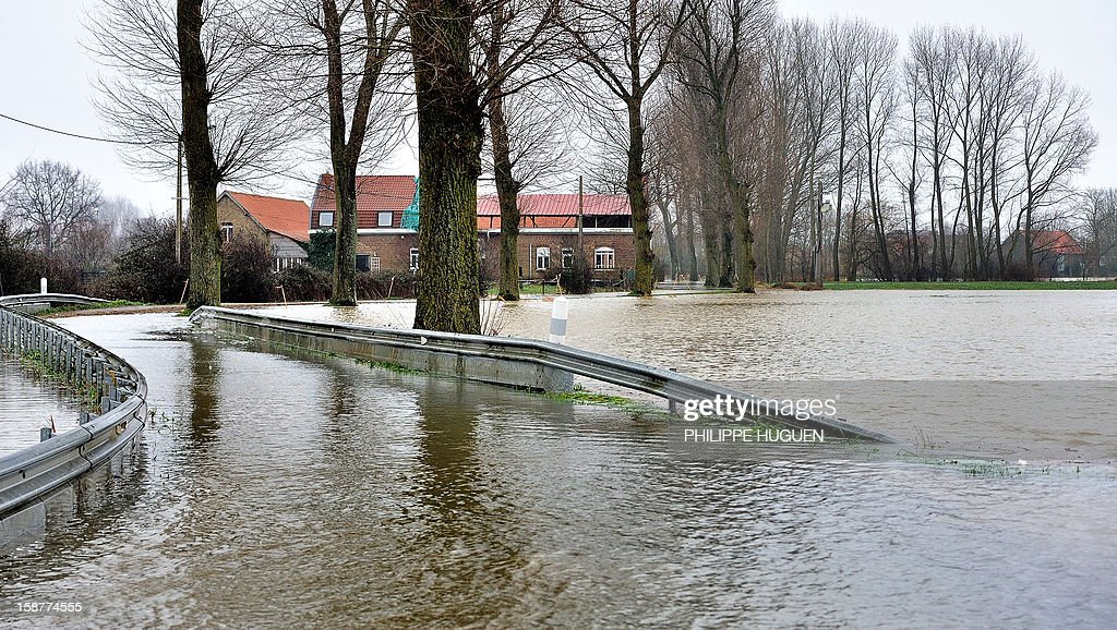 This picture taken on December 28, 2012 shows a flooded road after the overflowing of the Lys river caused by recent heavy rainfalls, in Merville, northern France.