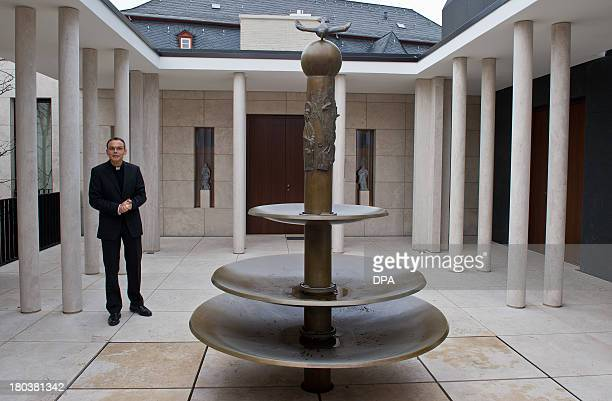 This picture taken on December 3 2012 shows Bishop of Limburg FranzPeter TebartzvanElst stand in the inner courtyard of the bishop's residence in...