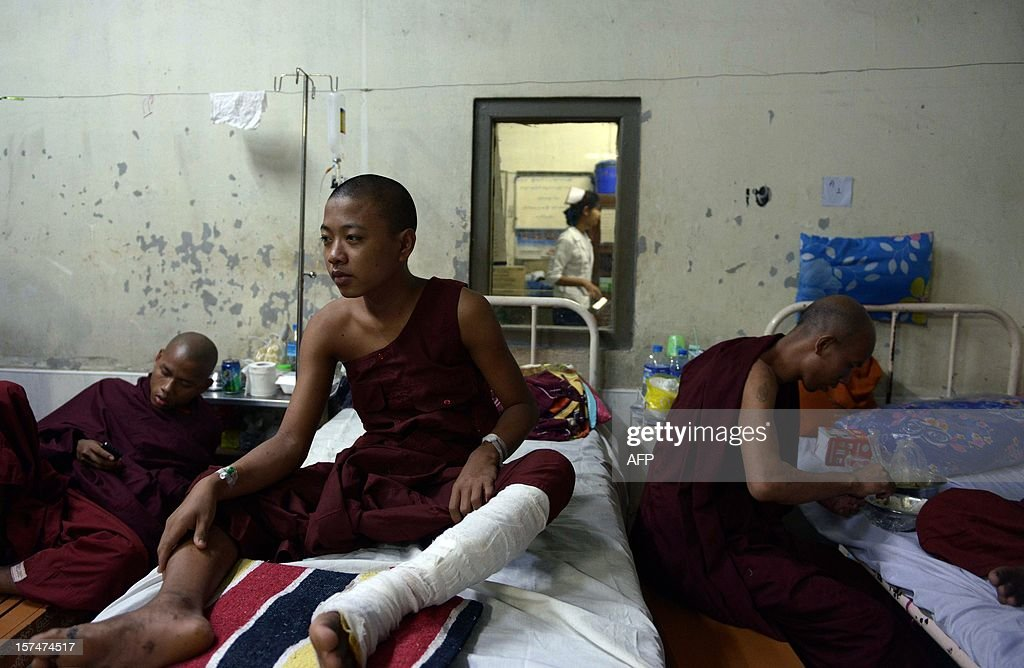 This picture taken on December 3, 2012 shows Buddhist monks who were injured in a crackdown on a protest at a Chinese-backed copper mine in Monywa, northern Myanmar, resting at a hospital after they were transferred for better treatment to Mandalay. Myanmar opposition leader Aung San Suu Kyi will lead a probe into the crackdown which will also assess the future of the contested project, the president's office said. AFP PHOTO/Ye Aung THU