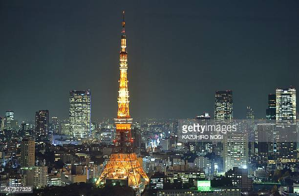 This picture taken on December 3 2013 shows Tokyo Tower illuminated at night in Tokyo The 333metrehigh communications and observation tower is the...