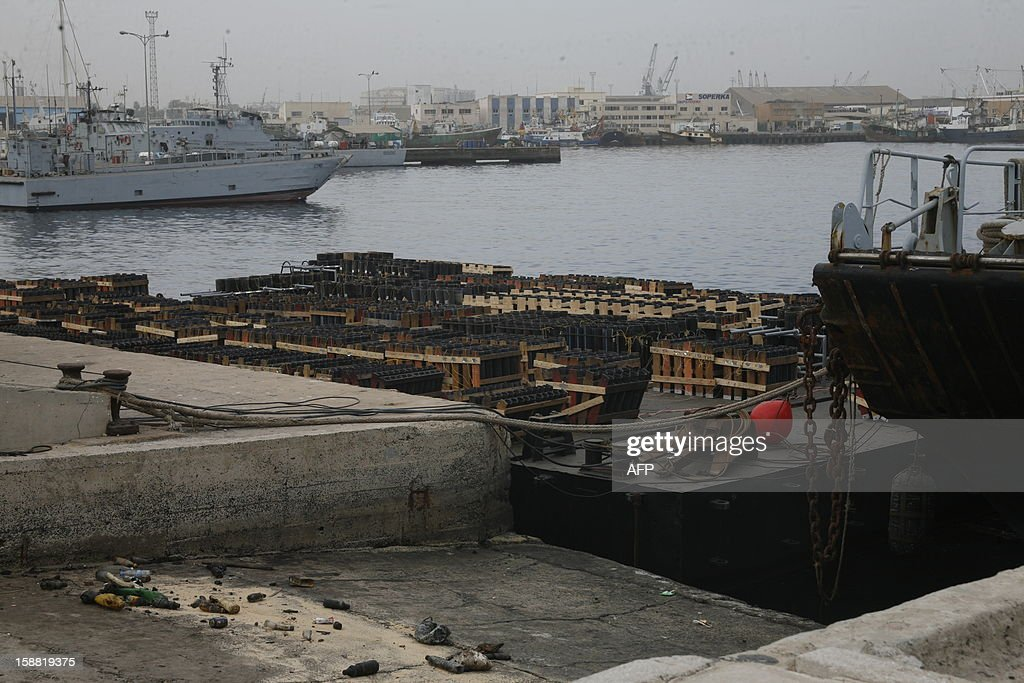 This picture taken on December 30, 2012 in the port of Dakar, shows fireworks waiting to be moved offshore and to be lit on New Year's Eve. Senegal's capital will organize the 'biggest fireworks' of its history and plans on using six tons of pyrotechnical material, operated by Portuguese pyrotechnists. AFP PHOTO / MAMADOU TOURE BEHAN