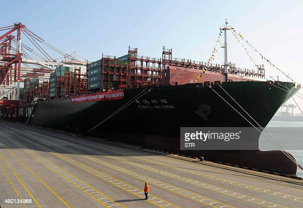This picture taken on December 4 2014 shows the China Shipping Container Lines CoLtd Globe berthing in Qingdao port during its maiden voyage to...