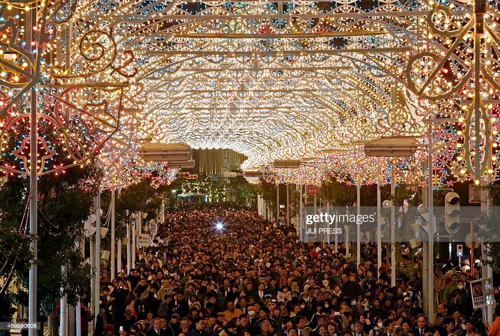 This picture taken on December 4 2014 shows the 'Kobe Luminarie' illumination with 200000 colorful bulbs at a shopping mall in Kobe in Hyogo...