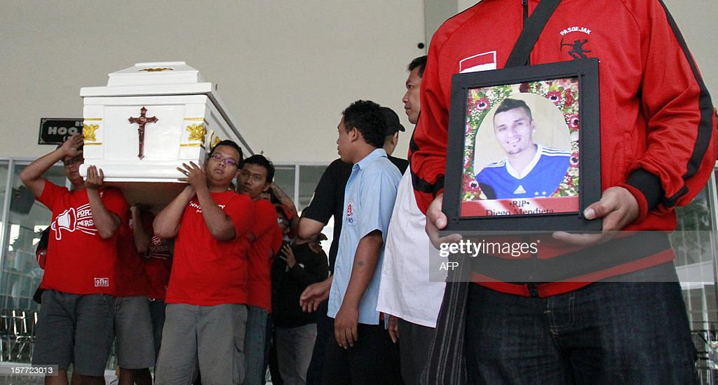 This picture taken on December 5, 2012 shows football players from Persis Solo club carrying the coffin of Paraguayan football player Diego Mendieta in Solo. Indonesia's football association slammed a rebel league on December 6 after a Paraguayan player who reportedly had not been paid in months fell ill and died because he couldn't afford medical treatment. Diego Mendieta, 32, a striker for Persis Solo, died from a viral infection, reports said, adding he was owed four months' salary of about 120 million rupiah (12,500 USD) and was unable to pay for treatment or fly home.