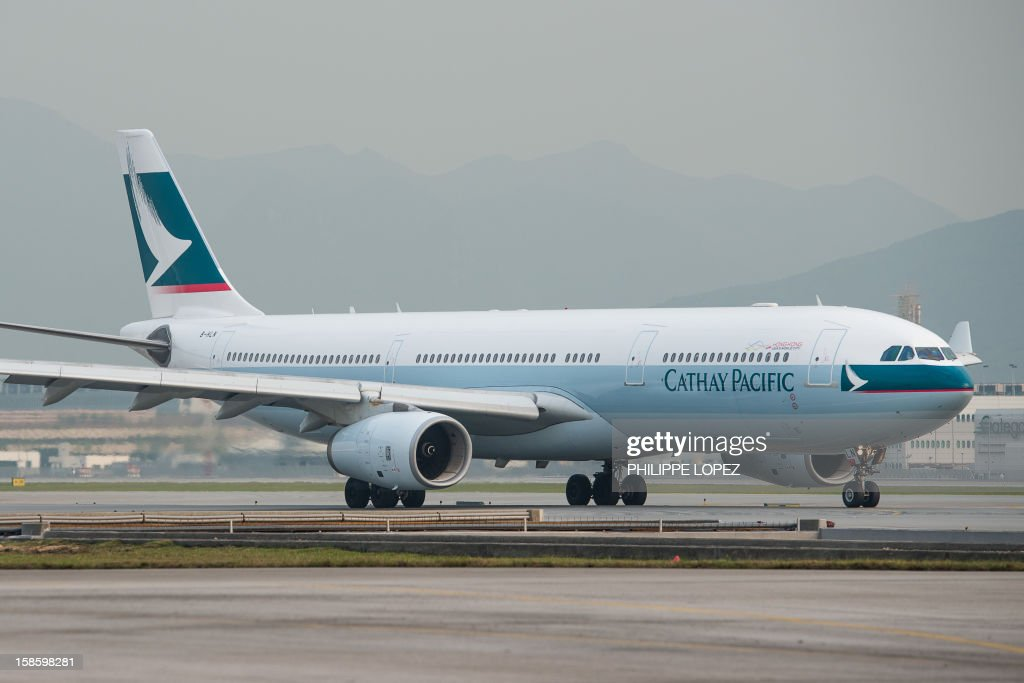 This picture taken on December 7 2012 shows a Cathay Pacific plane on the tarmac of the international airport in Hong Kong The union representing...