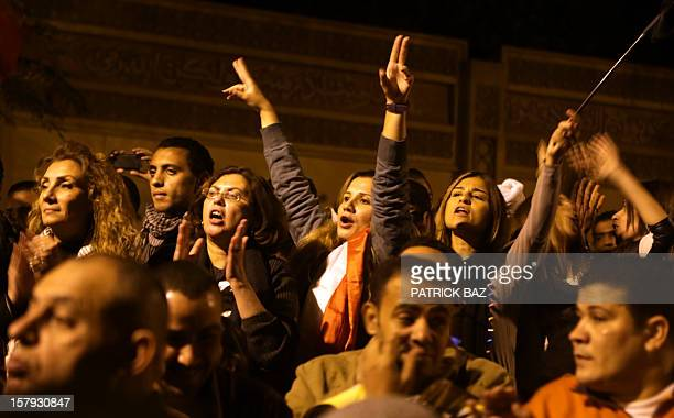 This picture taken on December 7 2012 shows Egyptian protesters shouting slogans against Egyptian President Mohammed Morsi as they attend a rally in...