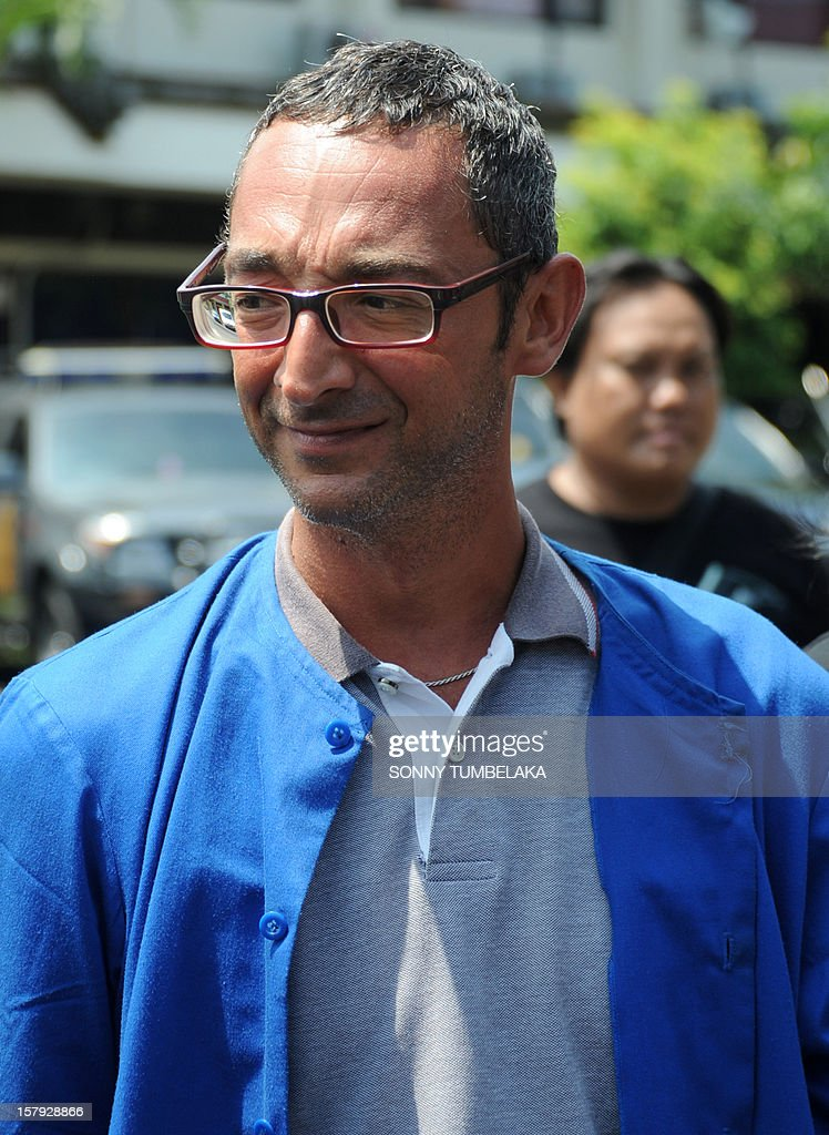 This picture taken on December 7, 2012 shows Italian fugitive mafia boss Antonino Messicati Vitale, 40, being escorted by Indonesian police following his arrest in Denpasar on Bali island. Italian police have arrested a fugitive mafia boss living in a luxury home on the island of Bali in a joint operation with Indonesian authorities, police said on December 7.