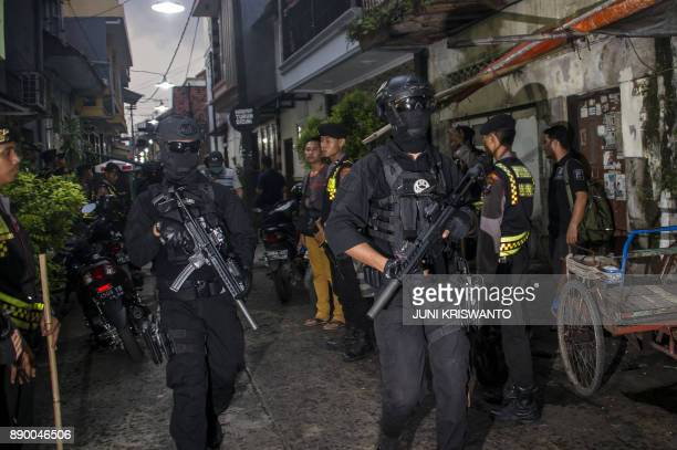 This picture taken on December 9 2017 shows Indonesian antiterror policemen conducting a raid in Surabaya More than a dozen people have been arrested...
