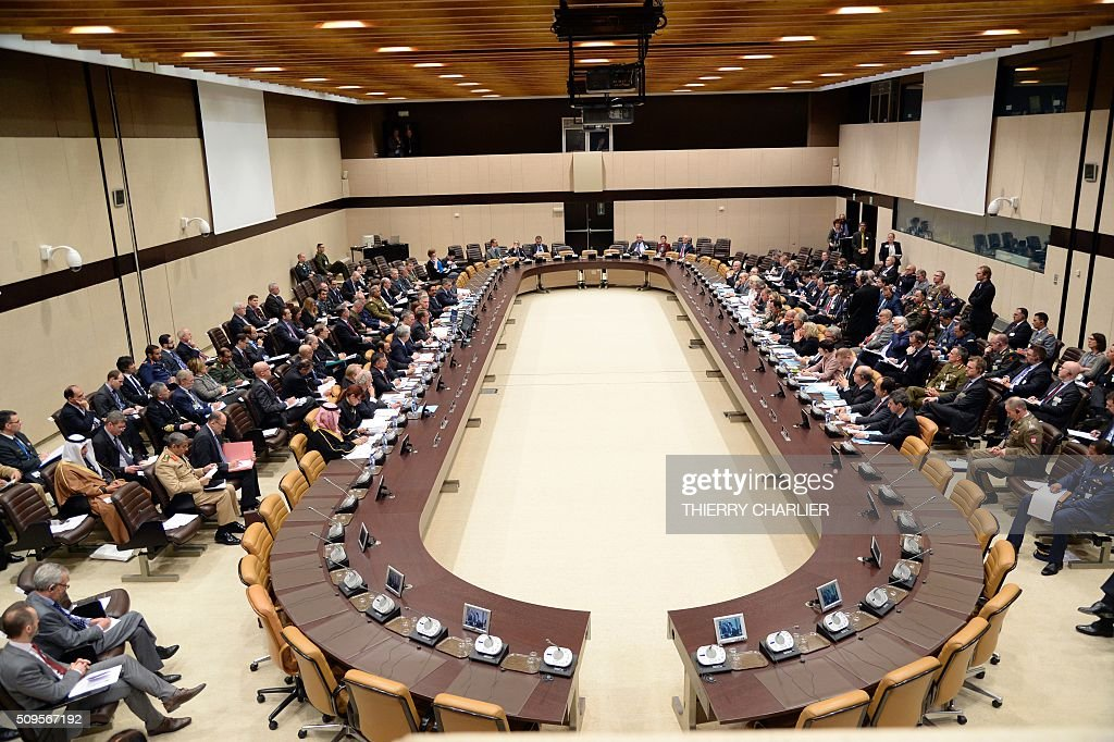 This picture taken on February 11, 2016 shows a general view of the proceedings during the Global Coalition meeting against The Islamic State group IS, held at NATO headquarter in Brussels. / AFP / THIERRY CHARLIER