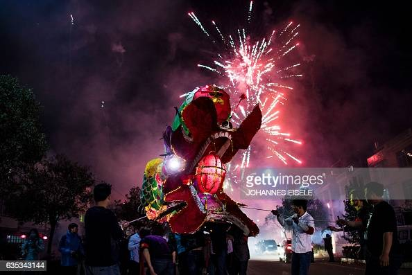 This picture taken on February 11 2017 shows villagers parading a dragon in Gutian village Liancheng county of China's eastern Fujian province...