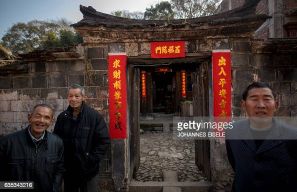 This picture taken on February 12 2017 shows villagers watching a dragon parade in Gutian village Liancheng county of China's eastern Fujian province...