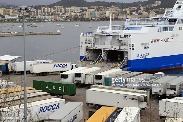 This picture taken on February 13 2016 shows the former SNCM ferry boat 'Jean Nicoli' docked at Ajaccio's port with trucks parked in front of its...