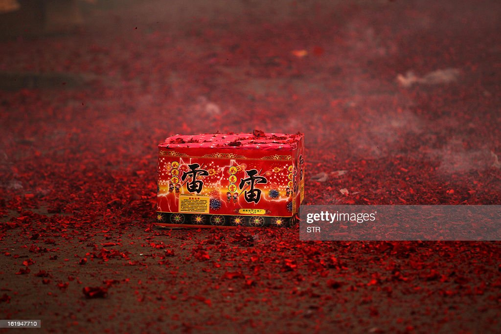 This picture taken on February 16, 2013 shows a firework package lying on the ground during celebrations of the Chinese lunar new Year of the Snake in Xuchang, central China's Henan province. The season is a peak period for fireworks producers, as Chinese traditionally buy the explosives to celebrate the festival, which fell on February 10 this year. CHINA