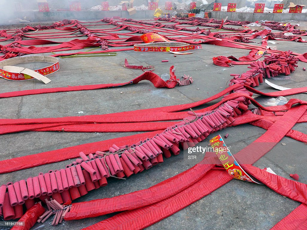 This picture taken on February 16, 2013 shows firecrackers displayed on the ground ahead of a firework display to celebrate the Chinese lunar new Year of the Snake in Shenyang, northeast China's Liaoning province. The season is a peak period for fireworks producers, as Chinese traditionally buy the explosives to celebrate the festival, which fell on February 10 this year. CHINA