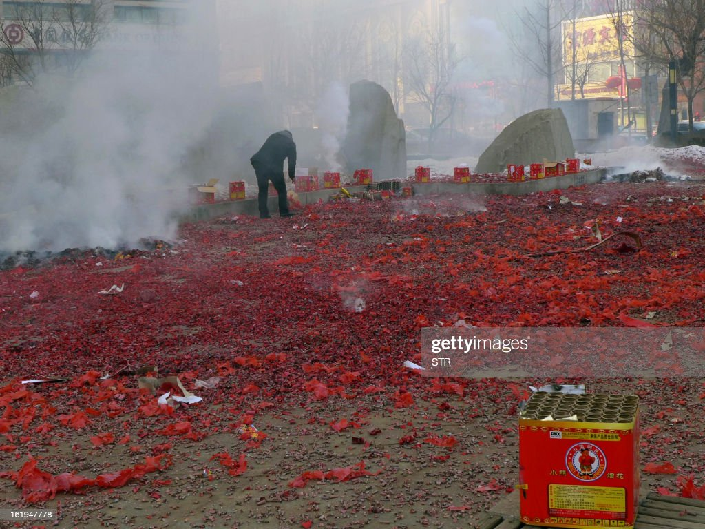 This picture taken on February 16, 2013 shows people preparing a firework display to celebrate the Chinese lunar new year in Shenyang, northeast China's Liaoning province. The season is a peak period for fireworks producers, as Chinese traditionally buy the explosives to celebrate the festival, which fell on February 10 this year. CHINA