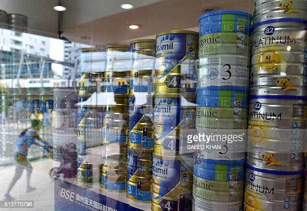 STORY 'AUSTRALIACHINAECONOMYHEALTHLIFESTYLE' FOCUS BY This picture taken on February 16 2016 shows a shop window displaying tins of baby milk formula...
