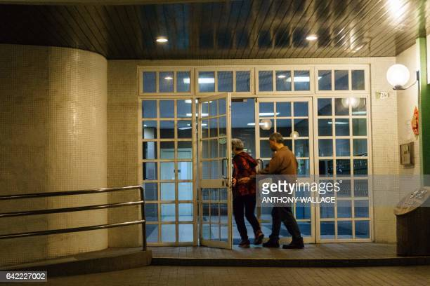 This picture taken on February 16 2017 shows a couple entering a residential building where Kim JongNam halfbrother of a North Korean leader Kim...